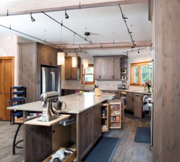An island with it all — seating, storage, appliances and a durable work surface