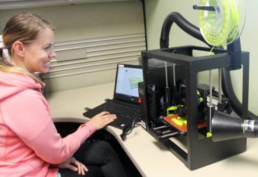 Liz Athey using a 3-D printer at the Gig Harbor Library