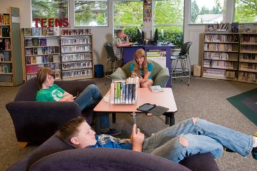 Teens with electronics at the Gig Harbor Library are a common sight.