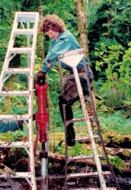 Dorothy Braid, Bob's wife, circa 1992. You know you're tough when you can operate a jackhammer while on a ladder placed in deep mud. (Photo courtesy Don McKinney)