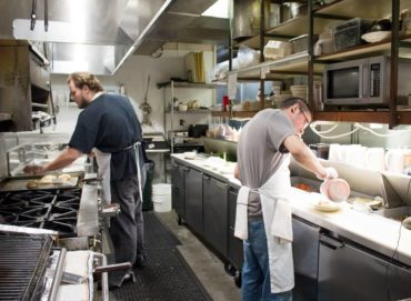 Line cooks busy in the ground-floor kitchen