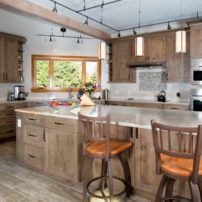 "On trend ""distressed wood"" plank porcelain floor tiles complement the rustic cabinetry."
