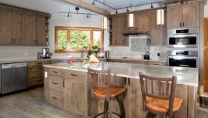 """On trend """"distressed wood"""" plank porcelain floor tiles complement the rustic cabinetry."""