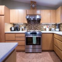 A multi-colored glass mosaic tile backsplash gives this kitchen a color punch.