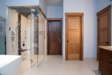Five carefully selected tiles comprise this steam shower with a vaulted ceiling.