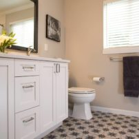 On-trend concrete tile with a Moroccan floor pattern gives this guest bath a cheerful look.