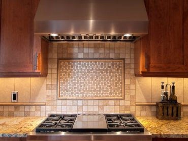This unique backsplash is comprised of six different stone and porcelain tiles designed by Teresa Staddler.