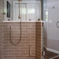 A textured wall tile and sliced pebble shower pan is right on trend.