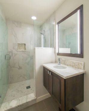 """Combining a large-format porcelain """"marble"""" tile with real marble mosaic tiles minimizes maintenance without sacraficing beauty."""