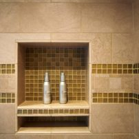 A custom shower niche blends in seamlessly with this three-tile shower surround.