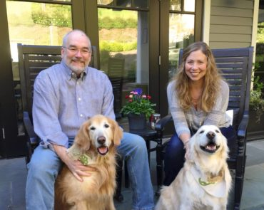 Craig and Jen Dolezal with their two golden retrievers, Charlie and Zoe