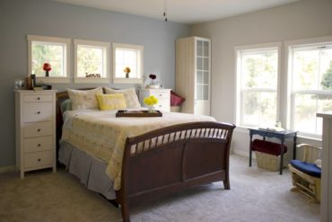Master suite features farmhouse décor.