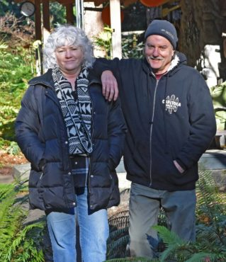 Dave and Lori Gibson in their woodland garden