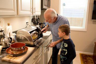 "Nick Parkinson preparing dinner in the ""apartment"""
