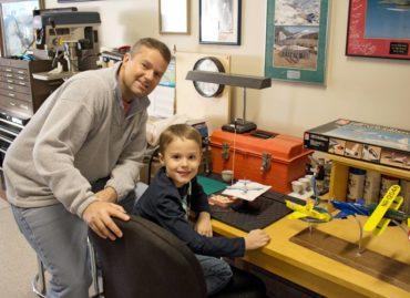 Darryl Parkinson and his son building metal airplanes