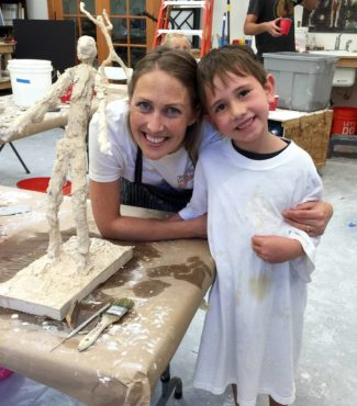 "Rees with Andrew Garcia after he completed art camp, where he created his very own ""Alberto Giacometti"" inspired sculpture in plaster."