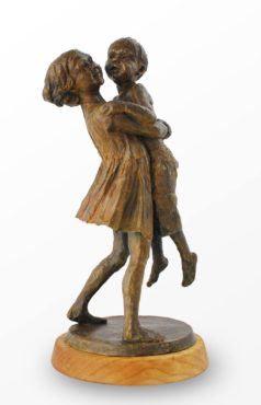 """Put Me Down!"" 2014, bronze: A 2-year-old boy is caught in the arms of his sister's loving embrace."