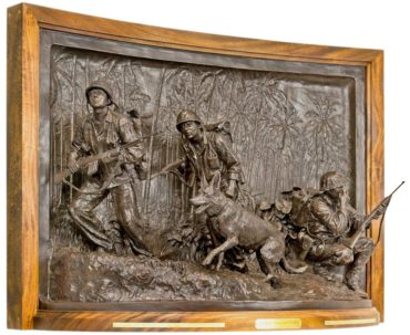 """Soul of the Forward and Faithful: WW II U.S. Marine Raider Memorial,"" 2014, bronze: Commissioned by the U.S. Marine Raider Foundation and Association for the National Museum of the Marine Corps, Washington D.C., Pentagon. Honoring the men who fought in America's first elite force, this memorial presents a group of U.S. Marine Raiders tackling sloped terrain in the Pacific jungle. The panel beyond depicts the thick vegetation, creating a theater-like context."