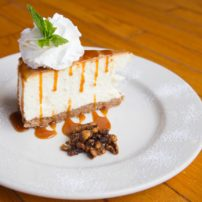New York Cheesecake — House-made New York style cheesecake with salted caramel, candied walnuts and whipped cream.
