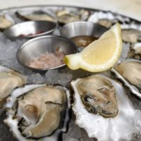Oysters on the Halfshell — Freshly shucked oysters from Minterbrook Oyster Farms just a few miles away from us in Purdy, WA. Served on the half shell with three mignonettes. Blackberry-thyme, champagne, and jalapeno-ginger. A true taste of the Pacific Northwest!