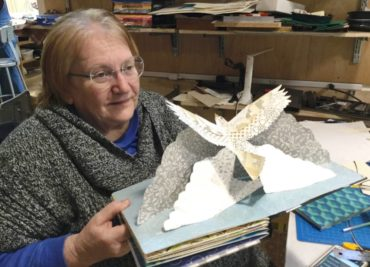 Book Arts Studio lead M.J. Christensen demonstrates 3D book making.