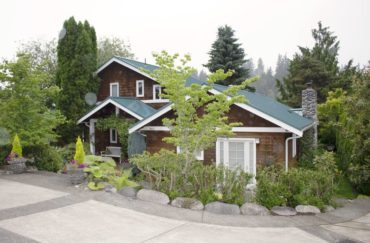 The front view of the home hides the delightful and colorful yards.