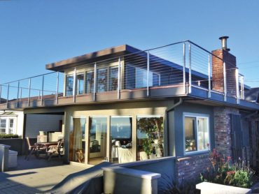 This beach home features a Rainier cable-railing system by AGS Stainless with stem reducers.