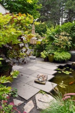 The sunken patio is nestled between the front entry and a lively koi pond.