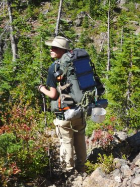 Robert Quill during a 40-mile backpacking trip last summer with his father; seen here on a trail on the north slope of the Mount Constance at an elevation of about 4,000 feet, after coming over the summit.