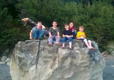 Boy Scouts Troop 220 relax on top of a rock at Third Beach (La Push) in Olympic National Park after hiking to the beach and setting up camp. Left to right are Cian Quill, Josh Helland, Aiden Myers-Sackett, Austin Mayger and Brandon DeWitt.