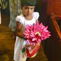 Beautiful Sri Lankan girl with flower offering