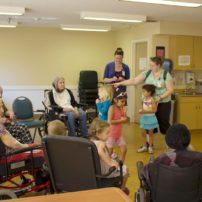 Children sing for the senior residents.