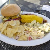 Deckside BBQ; (cheeseburger, potato salad, pasta salad, baked beans, kettle chips and corn)