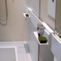 Keep your shower and bath area tidy with shelves that slide horizontally.