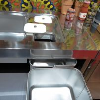 Compost storage integrated into a kitchen countertop