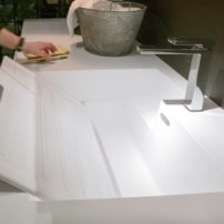 High-function laundry sink with integral scrub board