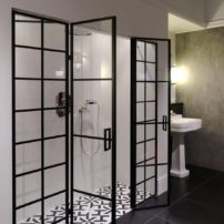 The flat-bar-metal look is trending in shelving and shower enclosures alike