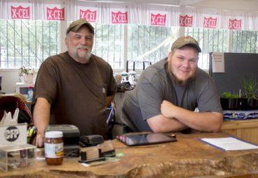 Rick Mielke, owner of Redneck Feeds, with helper