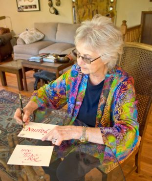Dee Fergusson writes with her custom calligraphy pens.