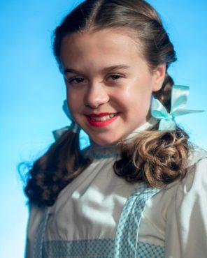 Emily Fox as Dorothy with Caesar Weaver as Toto (Photo courtesy Derek Villanueva)