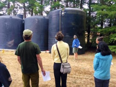 Stream steward trainees learn about the new cistern system installed at the Kitsap Conservation District in Poulsbo.