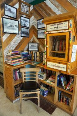 Historical photos and a free library at Al's Market in Olalla