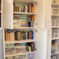 Inside the she shed: a wall of cupboards filled with Cheryl Falk's materials