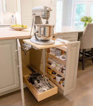 Base cabinet mixer lift with rollout accessory drawer and pullout pantry (Photo courtesy A Kitchen That Works LLC)