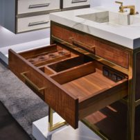 Plumbing drawer with built-in receptacle and drawer organizers by The Furniture Guild