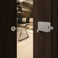 Surface-mount barn door lock by Inox