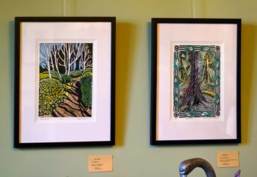 """""""Birch Garde"""""""" by Erica Applewhite and """"Bloedel Stroll"""" by Denise Cormier Mahoney are two of a dozen prints on display through June in the dining room in the residence at Bloedel Reserve."""