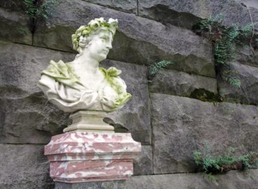 Four marble busts that represent each season line up under a pergola at the Biltmore Estates in Asheville, North Carolina.