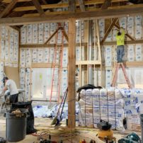 Insulating work on The Little White Barn, a Company + Cottage project