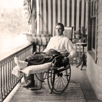 "Future baseball Hall of Famer Napoleon ""Larry"" Lajoie rests on his front porch as he recovers from a leg injury on July 18, 1905. (Louis Van Oeyen/Library of Congress)"
